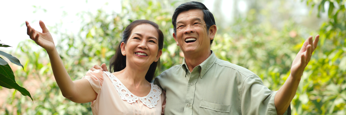 asian couple smiling in nature